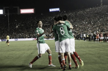 Mexico Players Celebrate Mexico's Second goal. Photo: Jae C hong- Associated Press