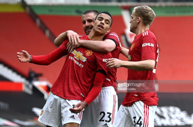 <div>MANCHESTER, ENGLAND - APRIL 18: Mason Greenwood of Manchester United celebrates with teammates Luke Shaw and Donny van de Beek after scoring his team's second goal during the Premier League match between Manchester United and Burnley at Old Trafford on April 18, 2021 in Manchester, England. (Photo by Gareth Copley/Getty Images)</div>