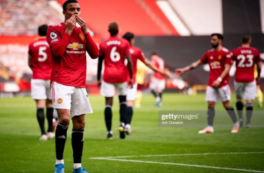<div>MANCHESTER, ENGLAND - APRIL 18: Mason Greenwood of Manchester United celebrates scoring a goal to make the score 2-1 during the Premier League match between Manchester United and Burnley at Old Trafford on April 18, 2021 in Manchester, United Kingdom. (Photo by Ash Donelon/Manchester United via Getty Images)</div>