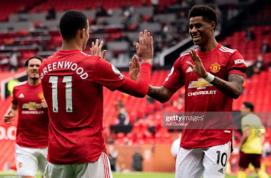 <div>MANCHESTER, ENGLAND - APRIL 18: Mason Greenwood of Manchester United celebrates scoring a goal to make the score 1-0 with Marcus Rashford during the Premier League match between Manchester United and Burnley at Old Trafford on April 18, 2021 in Manchester, United Kingdom. (Photo by Ash Donelon/Manchester United via Getty Images)</div>