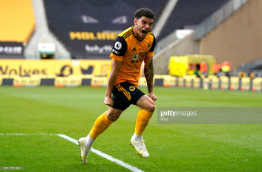WOLVERHAMPTON, ENGLAND - MAY 09: Morgan Gibbs-White of Wolverhampton Wanderers celebrates after scoring their sides second goal during the Premier League match between Wolverhampton Wanderers and Brighton & Hove Albion at Molineux on May 09, 2021 in Wolverhampton, England. Sporting stadiums around the UK remain under strict restrictions due to the Coronavirus Pandemic as Government social distancing laws prohibit fans inside venues resulting in games being played behind closed doors. (Photo by Tim Keeton - Pool/Getty Images)