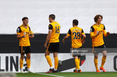WOLVERHAMPTON, ENGLAND - MAY 09: Morgan Gibbs-White of Wolverhampton Wanderers celebrates after scoring their sides second goal with team mate Conor Coady during the Premier League match between Wolverhampton Wanderers and Brighton & Hove Albion at Molineux on May 09, 2021 in Wolverhampton, England. Sporting stadiums around the UK remain under strict restrictions due to the Coronavirus Pandemic as Government social distancing laws prohibit fans inside venues resulting in games being played behind closed doors. (Photo by Naomi Baker/Getty Images)