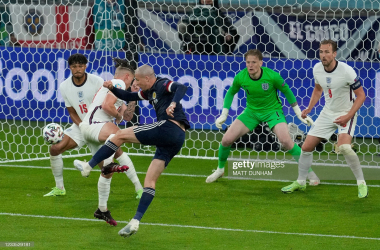<div>TOPSHOT-FBL-EURO-2020-2021-MATCH20-ENG-SCO</div><div>TOPSHOT - Scotland's forward Lyndon Dykes (3L) attempts on goal and fails during the UEFA EURO 2020 Group D football match between England and Scotland at Wembley Stadium in London on June 18, 2021. (Photo by Matt Dunham / POOL / AFP) (Photo by MATT DUNHAM/POOL/AFP via Getty Images)</div>