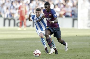 """<p class=""""MsoNormal"""" align=""""center"""" style=""""text-align:center"""">Corrida de un futbolista del Barcelona en el último cruce entre ambos. // Foto: fcbarcelona.es<o:p></o:p></p>"""