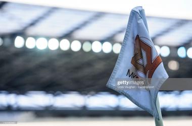 Mk Dons corner flag via Chris Vaughan-Getty Images
