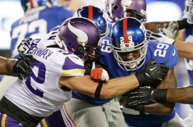 Michael Cox and the Giants running game pound their way through the Vikings.