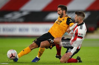 SHEFFIELD, ENGLAND - SEPTEMBER 14: Joao Moutinho of Wolverhampton Wanderers and Oliver Norwood of Sheffield United during the Premier League match between Sheffield United and Wolverhampton Wanderers at Bramall Lane on September 14, 2020 in Sheffield, United Kingdom. (Photo by Robbie Jay Barratt - AMA/Getty Images)