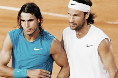 Carlos Moya (right) and Rafael Nadal meet at the net after a match back in Moya's playing days. Photo: Reuters