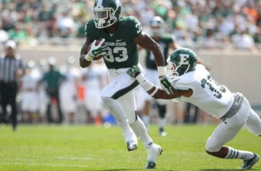 Jeremy Langford breaks a tackle. (Photo courtesy of @MSU_Football)