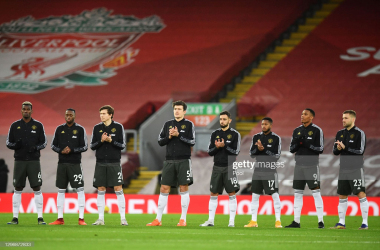 LIVERPOOL, ENGLAND - JANUARY 17: (L - R) Paul Pogba, Aaron Wan-Bissaka, Victor Lindelof, Harry Maguire, Bruno Fernandes, Fred, Anthony Martial and Luke Shaw of Manchester United take part in a minute of applause for Singer-songwriter, Gerry Marsden who recently past away ahead of the Premier League match between Liverpool and Manchester United at Anfield on January 17, 2021 in Liverpool, England. Sporting stadiums around England remain under strict restrictions due to the Coronavirus Pandemic as Government social distancing laws prohibit fans inside venues resulting in games being played behind closed doors. (Photo by Paul Ellis - Pool/Getty Images)