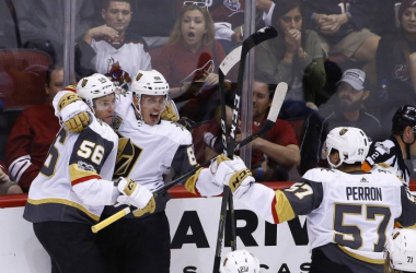 NATE SCHMIDT CELEBRATES A GOAL WITH TEAMMATES DAVID PERRON AND ERIK HAULA. (AP PHOTO/ ROSS D. FRANKLIN)