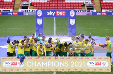 Norwich City celebrate as they lift the 2020/21 Sky Bet Championship title, and subsequently confirm their promotion to the Premier League<div>(Photo by George Wood via Getty Images)</div>