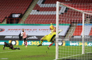 HEFFIELD, ENGLAND - JANUARY 17: Tanguy Ndombele of Tottenham Hotspur scores their side's third goal as Aaron Ramsdale of Sheffield United attempts to save during the Premier League match between Sheffield United and Tottenham Hotspur at Bramall Lane on January 17, 2021 in Sheffield, England. Sporting stadiums around England remain under strict restrictions due to the Coronavirus Pandemic as Government social distancing laws prohibit fans inside venues resulting in games being played behind closed doors. (Photo by Mike Egerton - Pool/Getty Images)