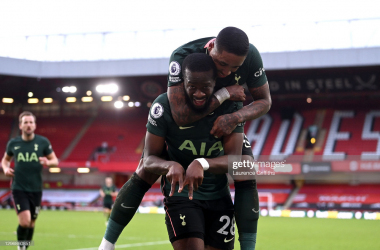 <div>SHEFFIELD, ENGLAND - JANUARY 17: Tanguy Ndombele of Tottenham Hotspur celebrates after scoring their sides third goal with team mate Steven Bergwijn during the Premier League match between Sheffield United and Tottenham Hotspur at Bramall Lane on January 17, 2021 in Sheffield, England. Sporting stadiums around England remain under strict restrictions due to the Coronavirus Pandemic as Government social distancing laws prohibit fans inside venues resulting in games being played behind closed doors. (Photo by Laurence Griffiths/Getty Images)</div><div><br></div>
