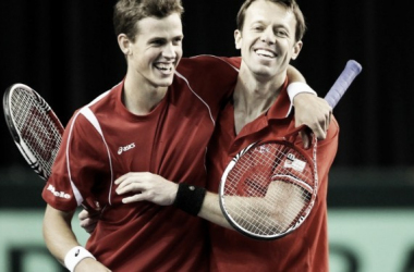 Vasek Pospisil (left) and Daniel Nestor embrace during Davis Cup play. Photo: Tennis Canada