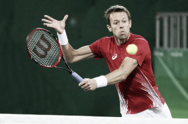 Daniel Nestor plays a shot at the Olympics last month. Photo: Jean Levac/Postmedia