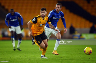 WOLVERHAMPTON, ENGLAND - JANUARY 12: Ruben Neves of Wolverhampton Wanderers in action with Gylfi Sigurdsson of Everton during the Premier League match between Wolverhampton Wanderers and Everton at Molineux on January 12, 2021 in Wolverhampton, United Kingdom. Sporting stadiums around England remain under strict restrictions due to the Coronavirus Pandemic as Government social distancing laws prohibit fans inside venues resulting in games being played behind closed doors. (Photo by Marc Atkins/Getty Images)