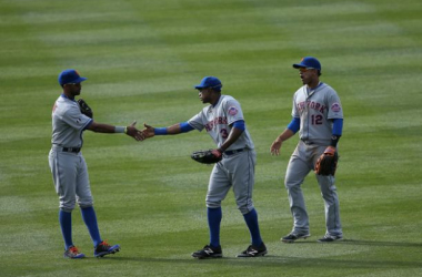 Outfielders Chris Young #1, Curtis Granderson #3 and Juan Lagares #12 of the New York Mets celebrate their victory over the Colorado Rockies at Coors Field on May 4, 2014 in Denver, Colorado. The Mets defeated the Rockies 5-1. (May 3, 2014 - Source: Doug