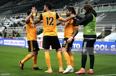 NEWCASTLE UPON TYNE, ENGLAND - FEBRUARY 27: Ruben Neves of Wolverhampton Wanderers celebrates with team mates Joao Moutinho, Willian Jose and Fabio Silva after scoring their side's first goal during the Premier League match between Newcastle United and Wolverhampton Wanderers at St. James Park on February 27, 2021 in Newcastle upon Tyne, England. Sporting stadiums around the UK remain under strict restrictions due to the Coronavirus Pandemic as Government social distancing laws prohibit fans inside venues resulting in games being played behind closed doors. (Photo by Owen Humphreys - Pool/Getty Images)