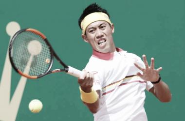 Nishikori em ação (Foto:VALERY HACHE/ AFP)
