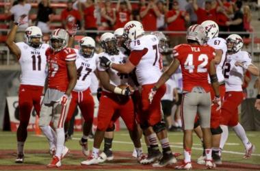NIU celebrates after a touchdown (AP Photo)