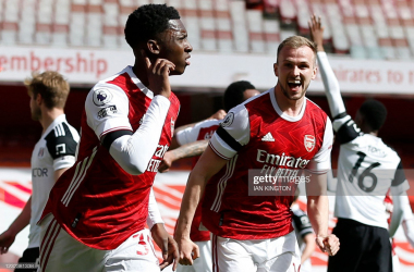 "Nketiah cups his ear in celebration after stabbing in the equaliser against Fulham on Sunday. <span style=""font-style: normal;"">GettyImages/Ian Kingston.</span>"