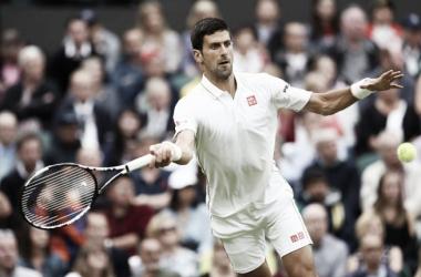 Wimbledon: Novak Djokovic goes through to the third round after a straight-sets win over Adrian Mannarino