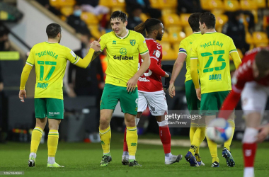 NORWICH, ENGLAND - JANUARY 20: Jordan Hugill of Norwich City celebrates with teammate Emi Buendia after scoring their side's first goal during the Sky Bet Championship match between Norwich City and Bristol City at Carrow Road on January 20, 2021 in Norwich, England. Sporting stadiums around the UK remain under strict restrictions due to the Coronavirus Pandemic as Government social distancing laws prohibit fans inside venues resulting in games being played behind closed doors. (Photo by Julian Finney/Getty Images)
