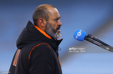 MANCHESTER, ENGLAND - MARCH 02: Nuno Espirito Santo, Manager of Wolverhampton Wanderers is interviewed on the pitch following the Premier League match between Manchester City and Wolverhampton Wanderers at Etihad Stadium on March 02, 2021 in Manchester, England. Sporting stadiums around the UK remain under strict restrictions due to the Coronavirus Pandemic as Government social distancing laws prohibit fans inside venues resulting in games being played behind closed doors. (Photo by Jack Thomas - WWFC/Wolves via Getty Images)