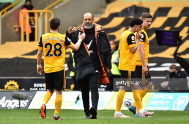 WOLVERHAMPTON, ENGLAND - MAY 09: Nuno Espirito Santo, Manager of Wolverhampton Wanderers interacts with Joao Moutinho after the Premier League match between Wolverhampton Wanderers and Brighton & Hove Albion at Molineux on May 09, 2021 in Wolverhampton, England. Sporting stadiums around the UK remain under strict restrictions due to the Coronavirus Pandemic as Government social distancing laws prohibit fans inside venues resulting in games being played behind closed doors. (Photo by Rui Vieira - Pool/Getty Images)