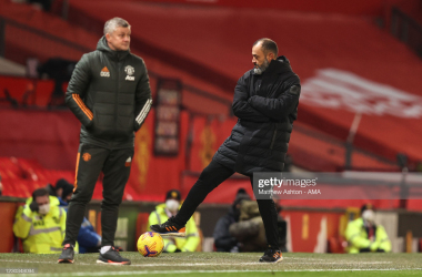 MANCHESTER, ENGLAND - DECEMBER 29: Nuno Espirito Santo the head coach / manager of Wolverhampton Wanderers controls the ball during the Premier League match between Manchester United and Wolverhampton Wanderers at Old Trafford on December 29, 2020 in Manchester, United Kingdom. The match will be played without fans, behind closed doors as a Covid-19 precaution. (Photo by Matthew Ashton - AMA/Getty Images)