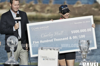 Charley Hull accepts the winner's check from LPGA Commissioner Michael Whan