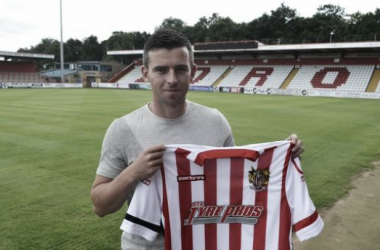 Schumacher poses with the strip of his new club. Photo source: Stevenage FC