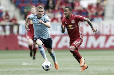 Alex Ring and Kaku meeting earlier in the season.| Photo: Brad Penner-USA TODAY Sports