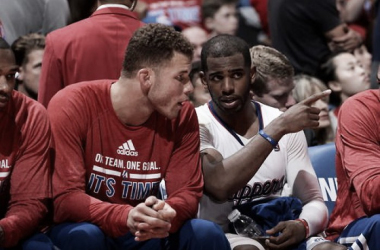 Chris Paul of the Los Angeles Clippers talks with teammate Blake Griffin in Game Two of the Western Conference Quarterfinals against the Golden State Warriors at Staples Center on April 21, 2014 in Los Angeles, California. (Photo by Andrew D. Bernstein/NB