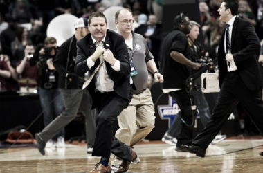 Head Coach Chris Beard of the Arkansas Little Rock Trojans reacts after Little Rock's 85-83 double-overtime win over the Purdue Boilermakers in the first round NCAA Tournament on Thursday, March 17, 2016. (Photo by AAron Ontiveroz/The Denver Post via
