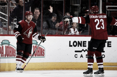 Max Domi #16 of the Arizona Coyotes celebrates with Oliver Ekman-Larsson #23 after Domi scored a second period goal against the Edmonton Oilers during the NHL game at Gila River Arena on January 12, 2016 in Glendale, Arizona. (Photo by Christian
