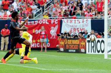 Raheem Sterling watches as his shot bounces into the Olympiakos net.