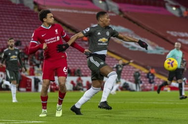 Trent Alexander-Arnold holds off Anthony Martial during the Premier League match between Liverpool and Manchester United at Anfield on January 17 2021 in Liverpool, England (Photo by Getty Images)
