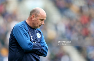 Paul Cook had harsh words for his Wigan players after a fifth defeat in a row last weekend at QPR.Photo by Lewis Storey/Getty Images.