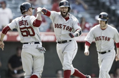 Dustin Pedroia (center) reacts to his clutch three-run home run in the ninth inning | Ryan Kang - AP