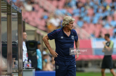 """<div><span style=""""font-style: normal;""""><b>West Ham manager Manuel Pellegrini looks on as his side compete in the PL Asia Trophy</b></span></div><div><span style=""""font-style: normal;""""><b>(PHOTO: Serena Taylor/Getty Images)</b></span></div>"""