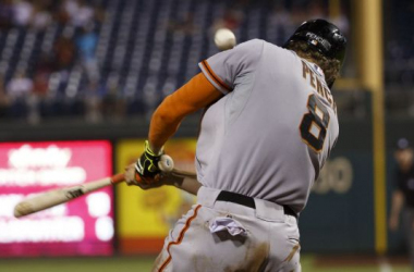 Hunter Pence hits a bloop to right field to give the Giants the lead in the 9th of the third game (Chris Szagola/AP)