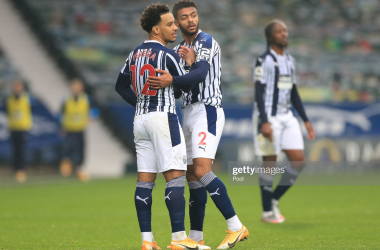 Darnell Furlong ushers Matheus Pereira of West Bromwich Albion off the pitch as he is sent off after a VAR review during the Premier League match between West Bromwich Albion and Crystal Palace at The Hawthorns on December 06, 2020 in West Bromwich, England. The match will be played without fans, behind closed doors as a Covid-19 precaution. (Photo by Mike Egerton - Pool/Getty Images)