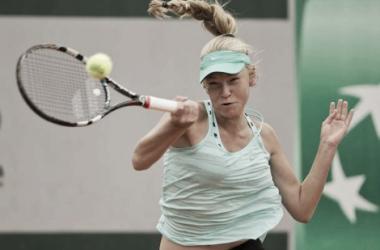 Olesya Pervushina hits a forehand during an early round match. Photo: Ubi Tennis