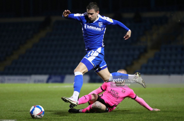 Olly Lee escapes the challenge of Joe Ward in Peterborough's 3-1 win at the Priestfield Stadium in February |Photo by James Chance/Getty Images