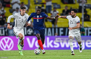 <div>&nbsp;Kai Havertz (L) and Ilkay Gündogan (R) of Germany challenges for the ball with Paul Pogba (C) of France during the UEFA Euro 2020 Championship Group F match between France and Germany at Allianz Arena on June 15, 2021 in Munich, Germany. (Photo by Markus Gilliar/Getty Images)<br></div>
