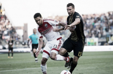 Chris Pontius battles Lamar Neagle for the ball.Image Courtesy of Bill Streicher-USA TODAY Sports