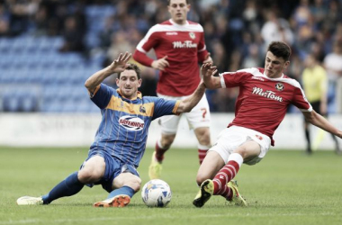 Poole [right] in action for Newport County last season - image viasouthwalesargus.co.uk