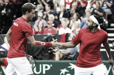 Vasek Pospisil (left) and Adil Shamasdin high-five during their victory on Saturday. Photo: Davis Cup